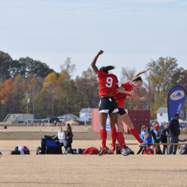 Senior Emily Keast celebrates with a teammate on her travel soccer team, seperate from high school. She is a WS Varsity track runner as well, and balences the two sports, while recieving offers to play both in college.