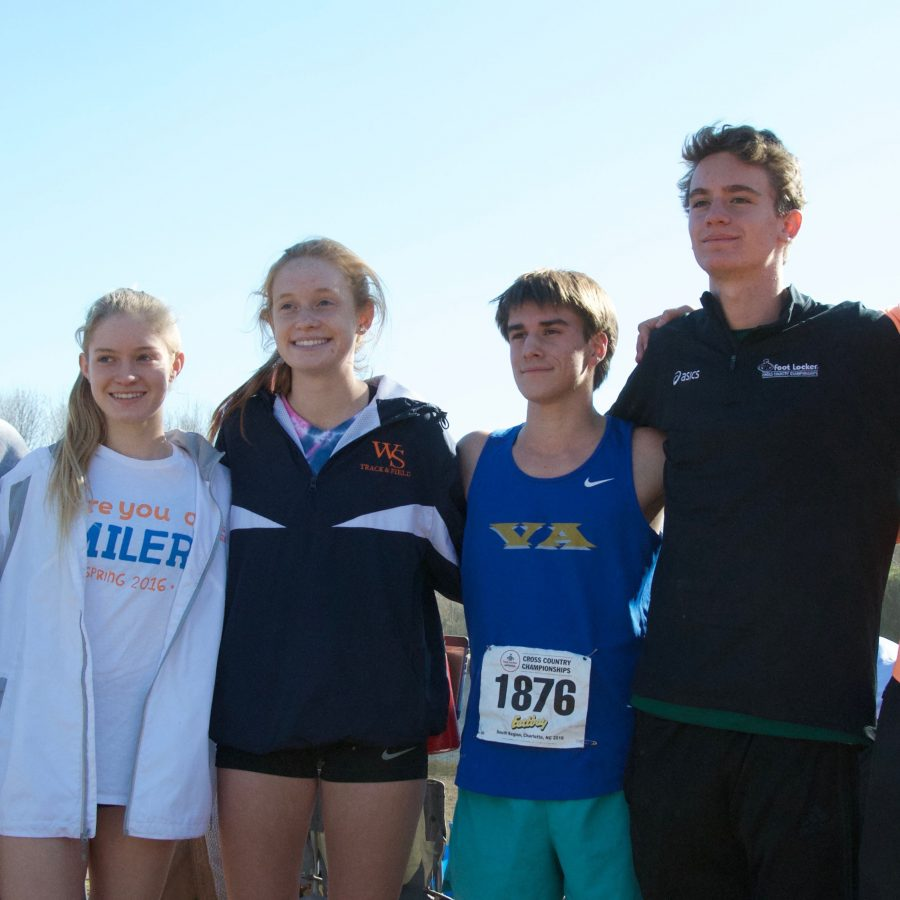 Cross+Country+Coach+Chris+Pelligrini+poses+proudly+with+Spartan+runners+who+participated+in+the+Footlocker+meet.