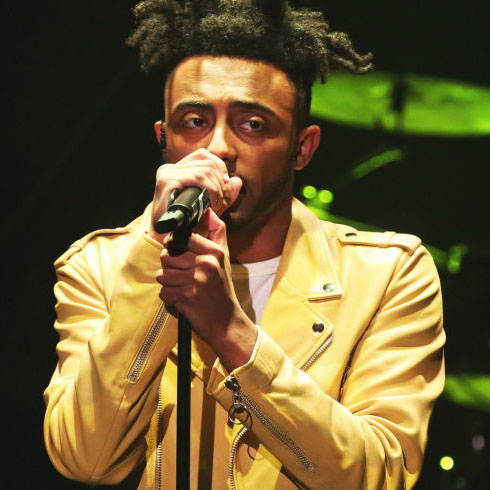 "With his performance on Jimmy Fallon's late night television show, breakout rapper Amine shocked the world with his freestyle after finishing his hit song ""Caroline."" He showcased his talent to the world, proving that he can rap about more important issues than a girl named Caroline."