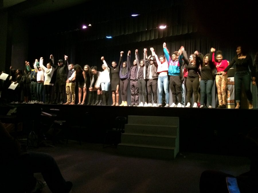 Students+who+performed+in+the+assembly+close+out+their+performances+with+a+bow.