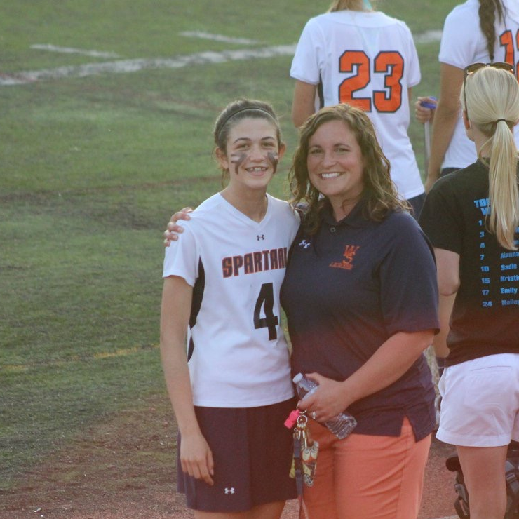 Former field hockey coach and current Assistant Student Activities Director Rosie Donaldson and junior Diana Criste at a 2015 Spartan lacrosse game.