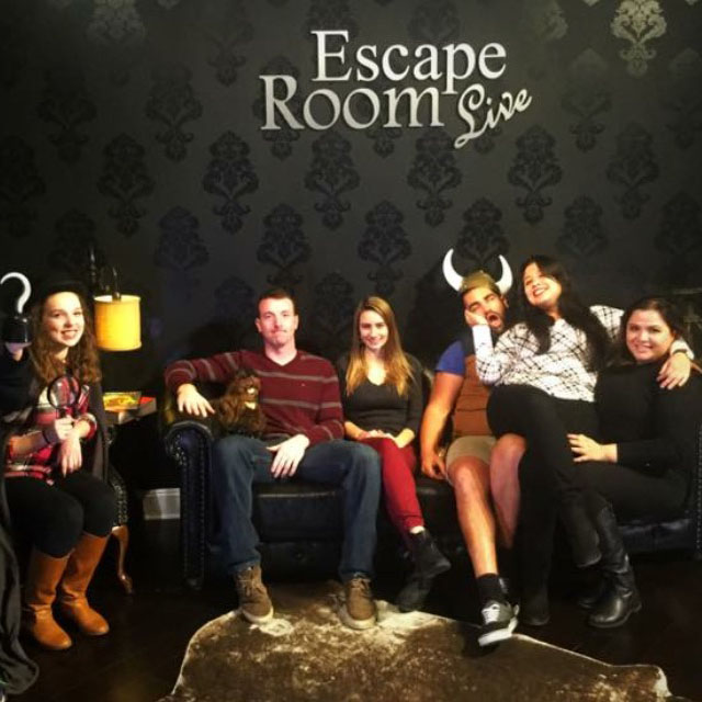 Escape Room Live takes a picture of each group after the end of each game.  They provide an array of props to ensure that the pictures are as goofy as possible before placing the photos on their Facebook page.