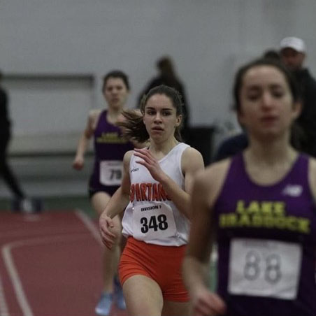 Rachel Mayberry runs her way around the track at NB Nationals.