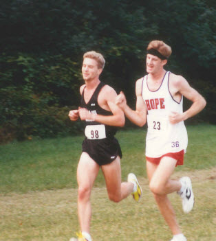 A young Brian Heintz (left) running energetically in the early 1990s for Kalamazoo