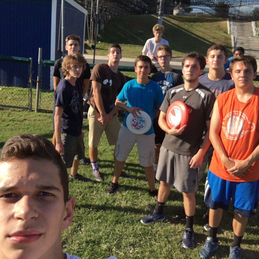 The+WS+frisbee+club+takes+a+break+from+one+of+their+meetings+consisting+of+running+around+and+throwing+frisbrees+to+each+other.+The+club+meets+Wednesdays+and+Fridays+on+the+football+field+and+anyone+is+open+to+join.