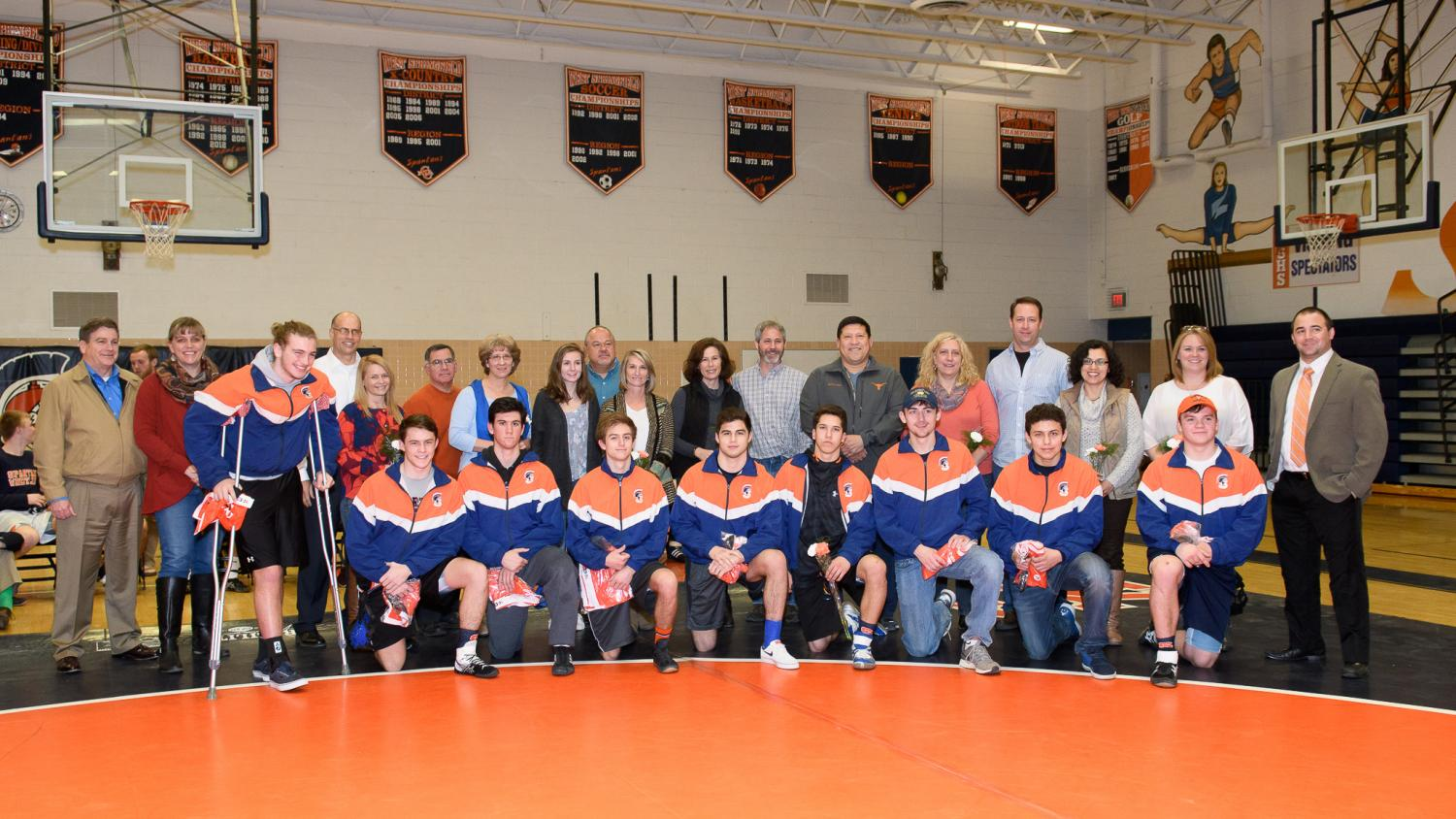 The senior class of the wrestling team before their final home competition.  The seniors led the wrestling team to a 6-1 conference record and two of the three Spartan wrestlers who went to the state tournament were seniors.