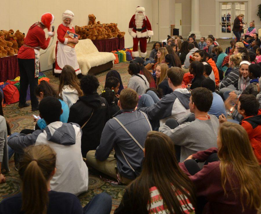 Santa Claus made an appearance at Kristi's Christmas, an annual event where Spartans help underprivilileged kids prepare for the holidays by taking them to target to buy gifts for their families.