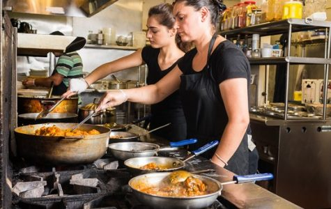 Balancing academics and cooking Afghan cuisine