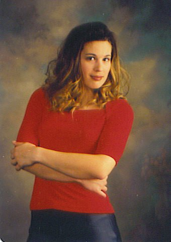 Stephanie Van posing for her school picture at her old high school, Turtle Mountain Community High School.