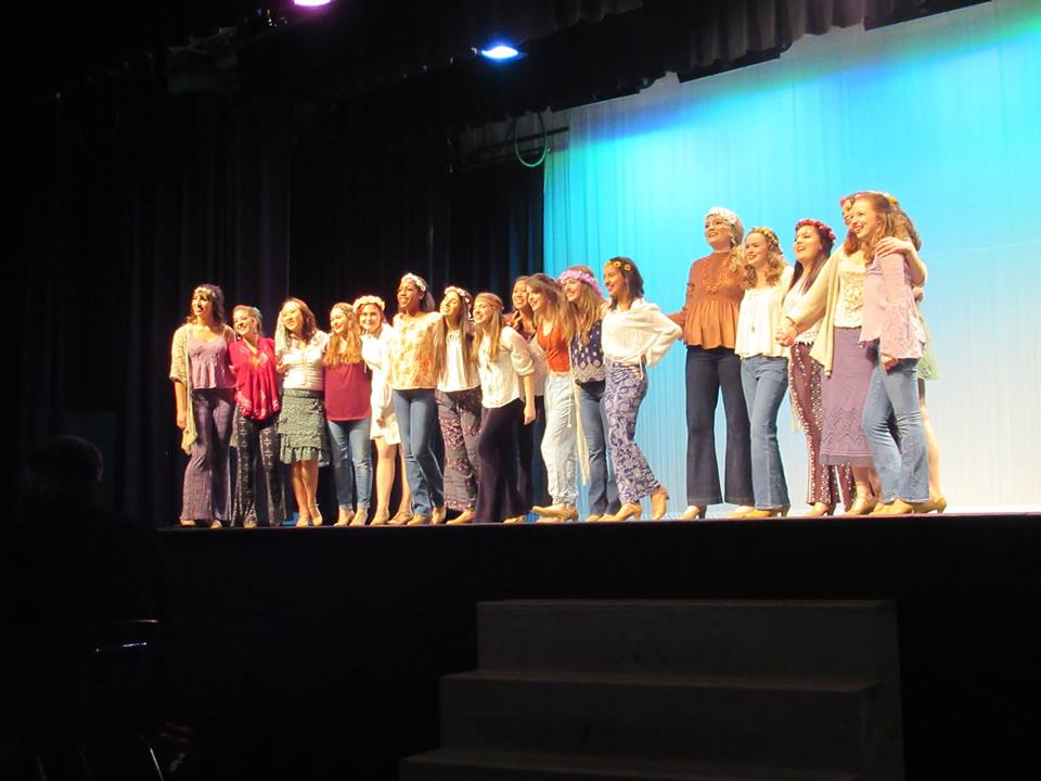 """Personality Show Choir performs their opening number, """"Aquarius/Let the Sun Shine In"""" on Thursday night."""