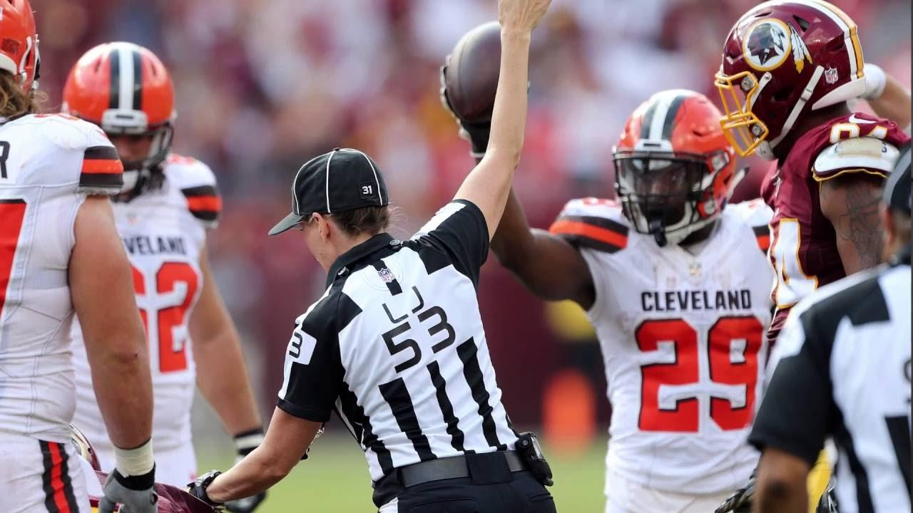 Cleveland Browns running back Duke Johnson showing the referee he has the ball.  Johnson recovered his own fumble in a game against the Redskins, but the referees gave the ball to the Redskins.