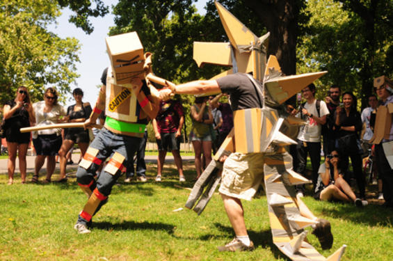 Two people compete in a one-on-one duel in the park. Cardboard tube dueling started back in 2007 with the founding of the CTFL and the sport has grown in popularity since.