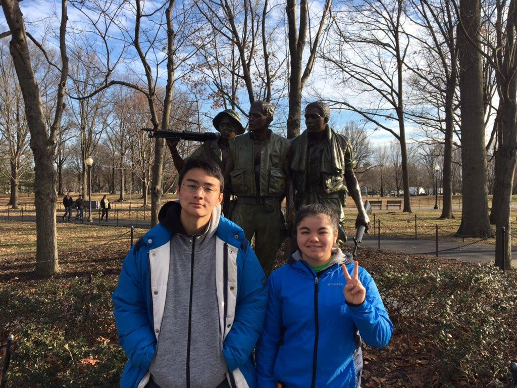 Stefanie Takenaka flashes a peace sign wither her Japanese exchange student, Leo Muramatsu, when she took Muramatsu downtown to explore in Washington, DC.