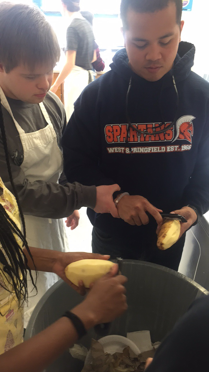 Senior Samuel Schwartz, who is on the left, gets cooking in the Gourmet Foods' kitchen. Next to him is his teacher IA Joe Ibanez.