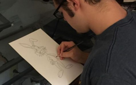 Niko Porter, WS freshman, sketches a picture of a rabbit, Frank, for his next cartoon. He uses these sketches to help him draw the character accurately.