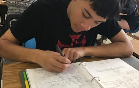 Senior Paul Hughs works diligently as he prepares for his upcoming AP exam. He, along with other WS students, is excited to continue learning after tests end.