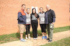 Brian Puhlick, Katie Tinsley, Alexa Romano, Emily Geary, and Greg Plasters were all involved in this year's Racoon Run
