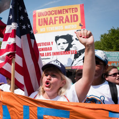 Protester defends undocumented children that were protected under the DACA  act.