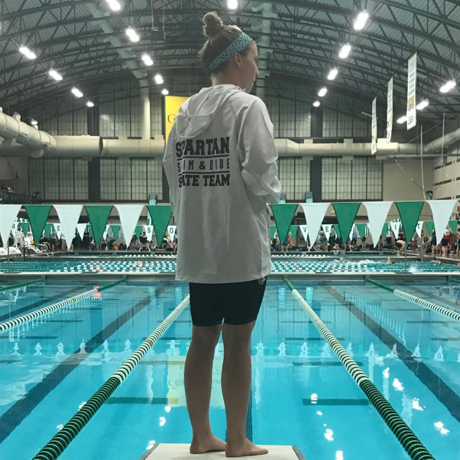 Senior Caroline Wittich looks over the pool before she competes. Meets such as these are sanctioned by VHSL.