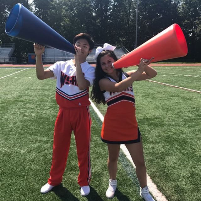 Varsity+cheerleaders+Michael+Woo+and+Julia+Coronado+practice+their+routine+for+highschool+football+games+and+upcoming+competitions.