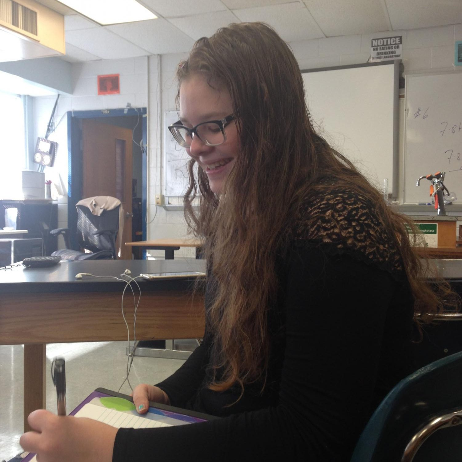 Junior Annika Sypher happily doing work in her Probability Statistics class.