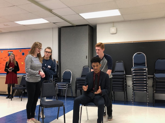 Seniors+Eila+Nash%2C+Eliza+Moss%2C+and+Yosef+Etana+and+junior+Brandon+LaBarge++perform+short+plays+they+created+about+real+issues.
