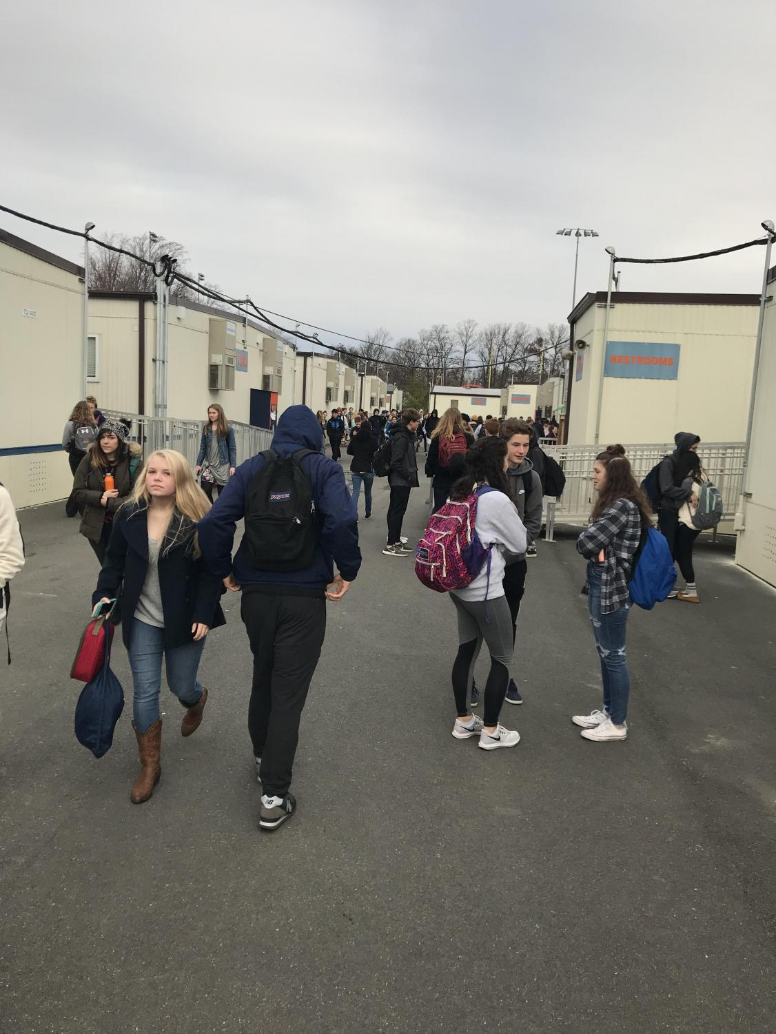 WS students walking in the cold weather anticipating snow in the future.