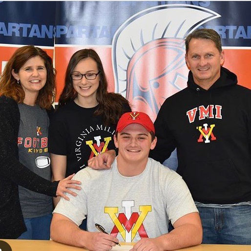 Senior Nick Hartnett poses with his family after earning a football scholarship to the Virginia Military Institute (VMI). Hartnett is an example of a hardworking athlete who was rewarded after succeeding both in school and on the field. This balance is critically important.