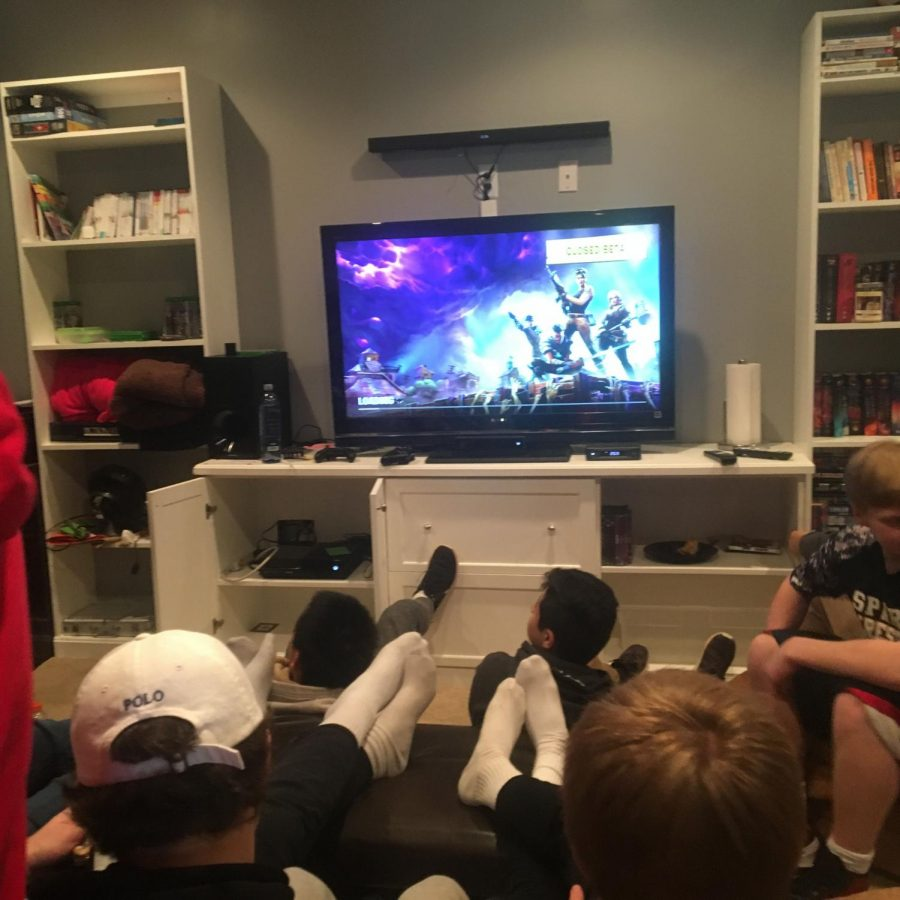 The wrestling team gathers to play Fortnite which allows them to bond over getting that Victory Royale.