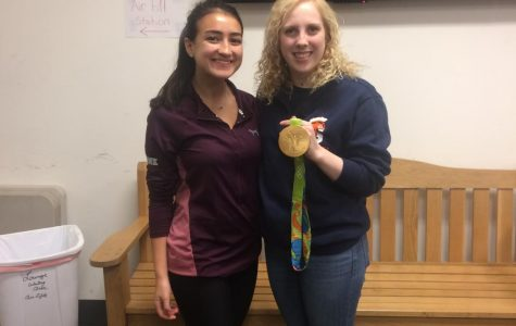 Junior Lauren Gagliano poses with Ginny Thrasher, who shows off her gold medal for air rifle. Thrasher is a WS alumnus and won their first medal of the 2016 games.