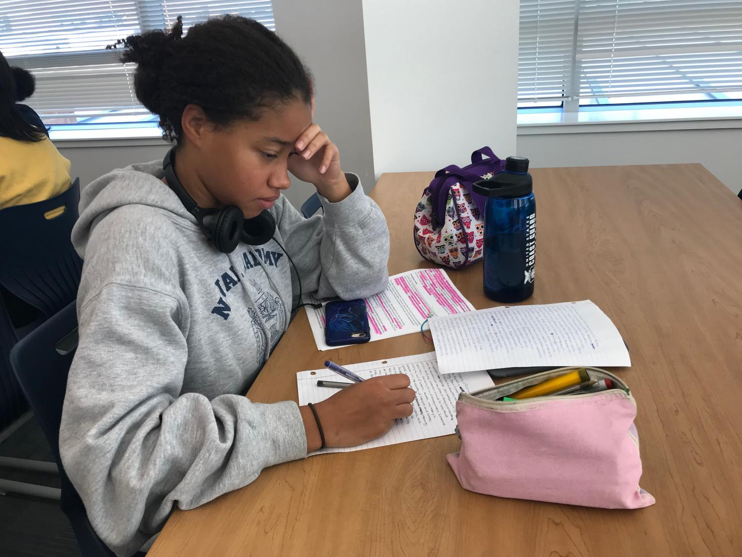Senior Hannah Perine works in the library as schoolwork, in conjunction with extracurricular, can often lead to stress.