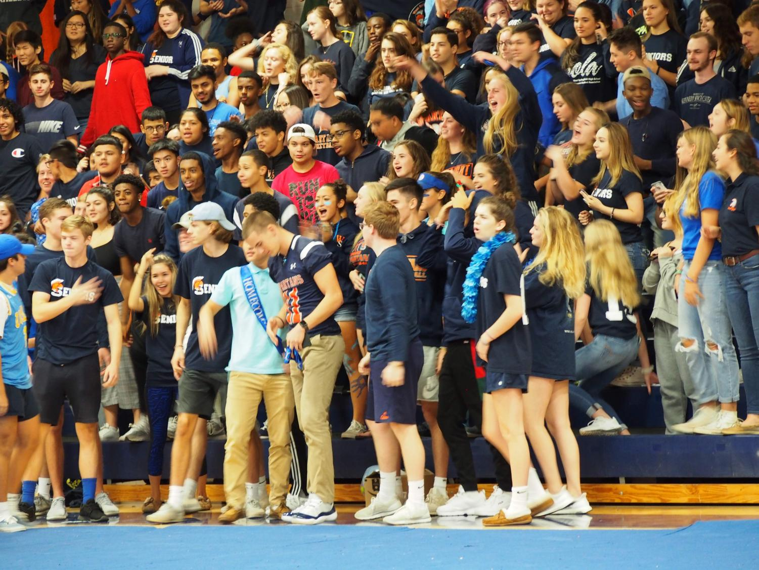 Seniors yell at the Homecoming pep rally; that yelling occasionally took the form of booing.