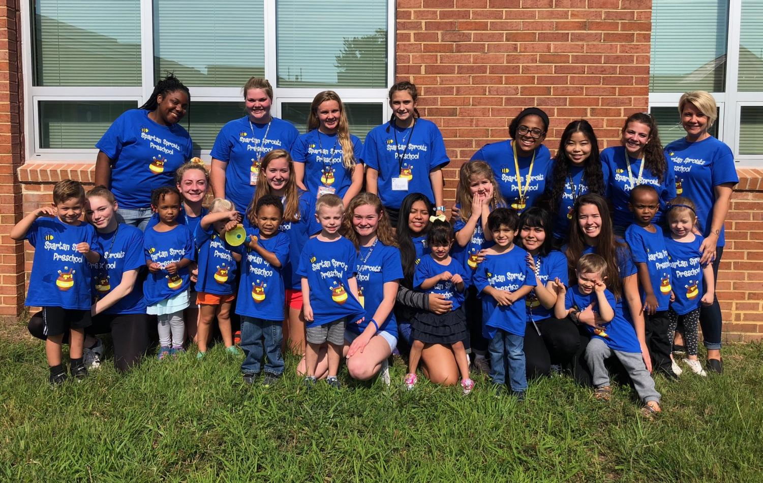 The teachers, students, and children who participate in the Spartan Sprouts program pose for a picture in the school courtyard. Spartan Sprouts pre-school is staffed by students in the Early Childhood Careers class.