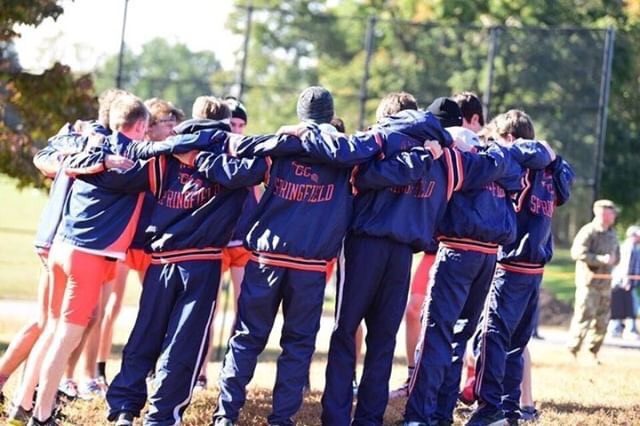 The+Boys+XC+team+huddles+to+prepare+for+regionals.+They+would+take+a+commanding+victory+in+the+meet+and+would+move+on+to+place+2nd+in+States.+