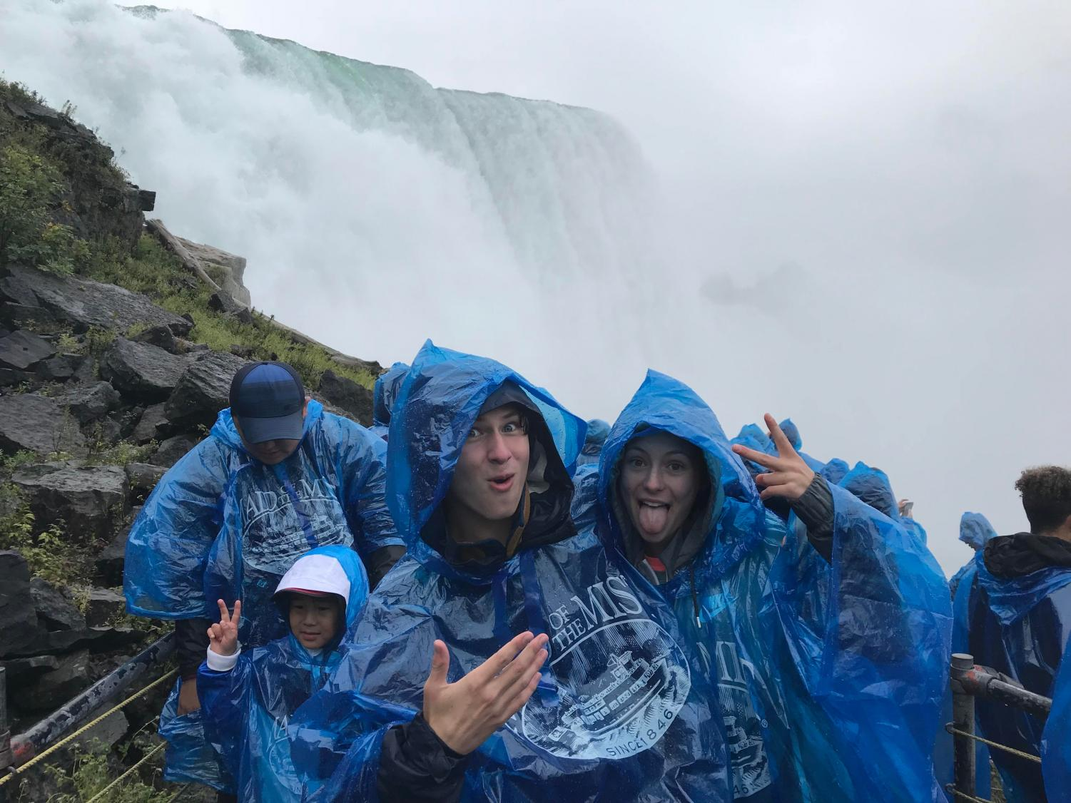 Cross country runners Sean Stuck and Amy Herrema clown around at Niagra Falls. They went to McQuaid Invitational in New York in late September. Some runners missed the Homecoming dance to compete in Rochester instead.
