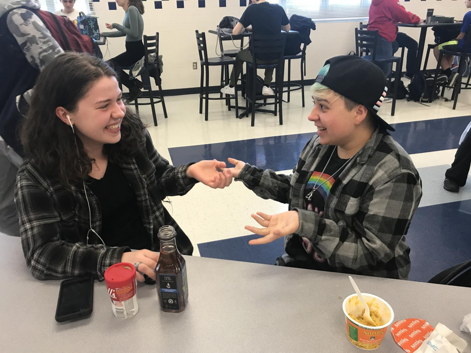 Seniors Sydney Anderson and Charlie Peterson chat at lunch about upcoming GSA meetings and recent developments from the FCPS School Board on the topic of gender inclusivity.