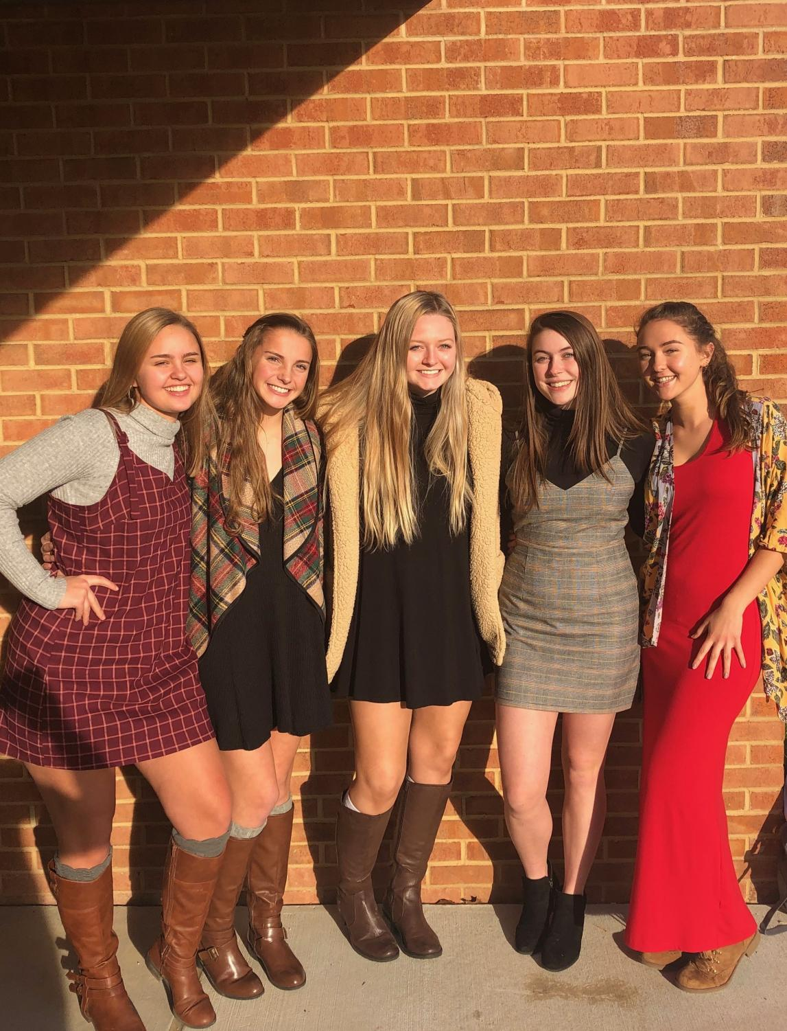 Juniors Lauren Bashan, Becca Giles, Caroline Guge, Elsa Iannotta, and Maeve Hennessy pose outside of WSHS in order to demonstrate their determination to bring change on human trafficking by participating in Dressember this year.