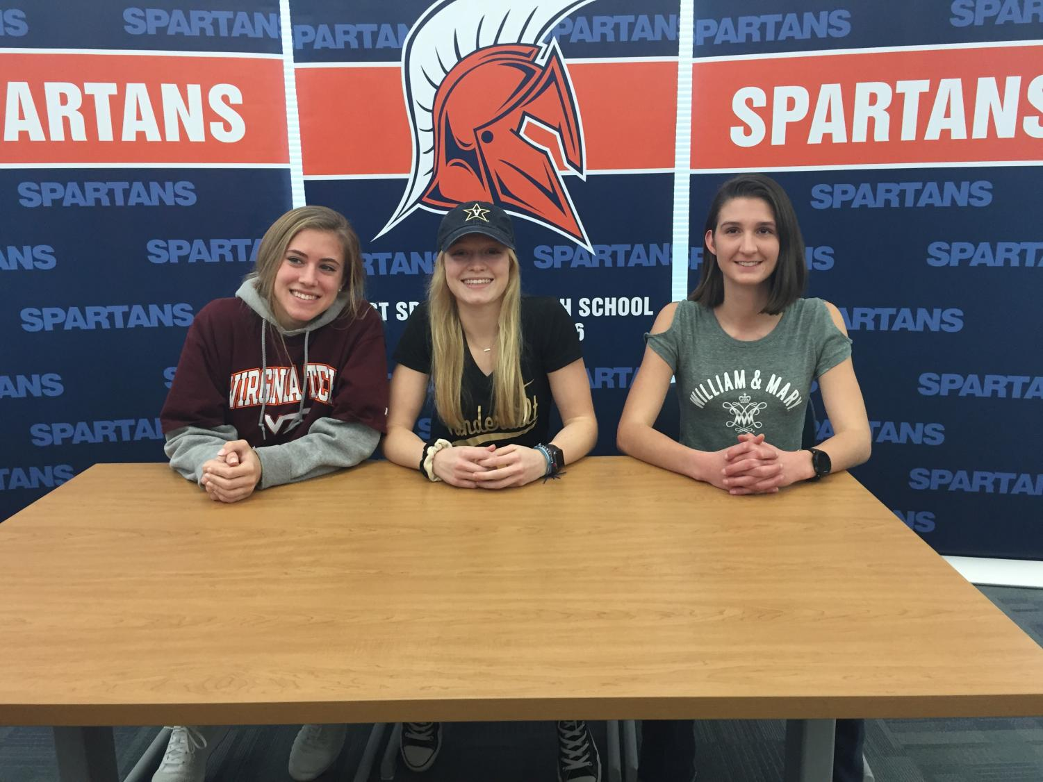 From left to right, seniors Chase Kappeler, Sarah Coleman, and Hope Stephens pose for a picture on their signing day. All three are to run: Kappeler at Virginia Tech, Coleman at Vanderbilt, and Stephens at William and Mary.