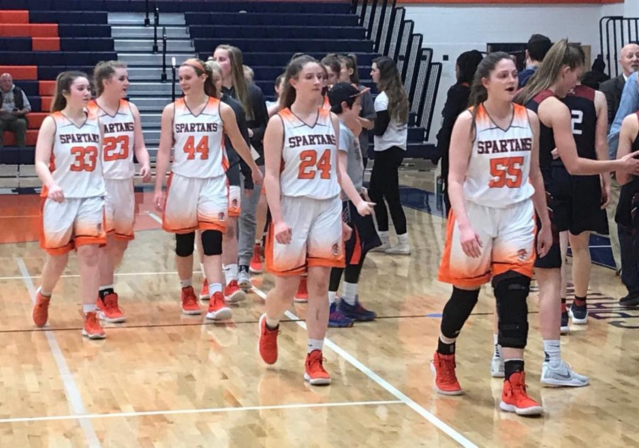 The+WS+Girls%27+Varsity+basketball+team+walks+off+the+court+after+securing+a+victory+against+Lake+Braddock%2C+earning+themselves+a+first+round+bye+at+the+district+tournament.+The+final+score+of+the+game+was+a+close+32-31%2C+Spartans+on+top.