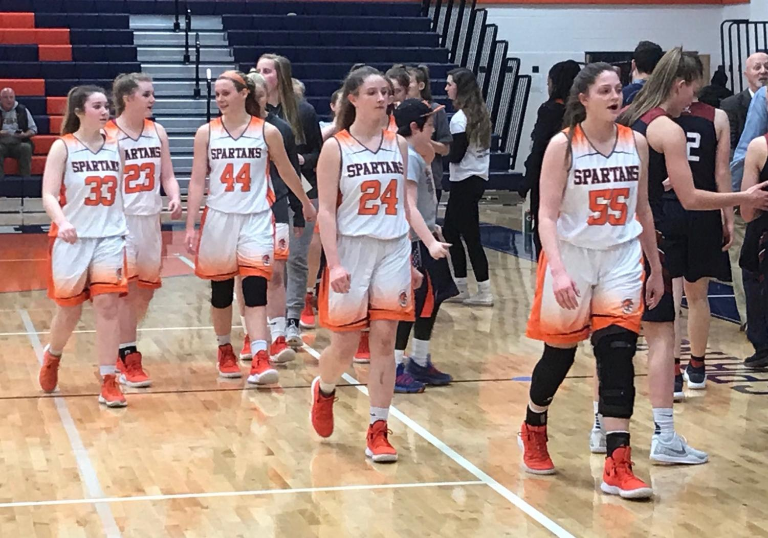 The WS Girls' Varsity basketball team walks off the court after securing a victory against Lake Braddock, earning themselves a first round bye at the district tournament. The final score of the game was a close 32-31, Spartans on top.