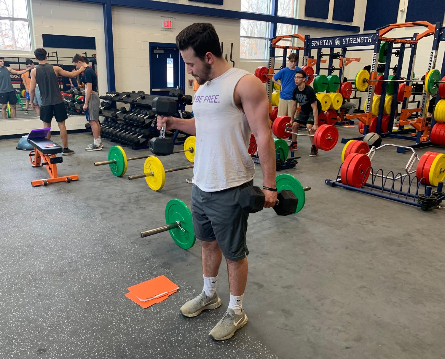 Senior Jeffery Beavers builds his upper body in his personal fitness class using the school's new dumbbells and equipment. Beavers has been part of the personal fitness program since sophomore year.