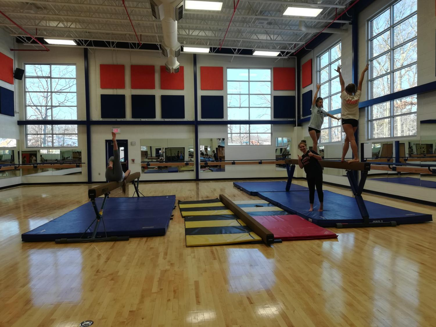 WS gymnasts use the new room to practice their beam routine after school. The new studio allows the gymnastics team to schedule their practices more conveniently and provides a better floor surface than the cafeteria for dance.