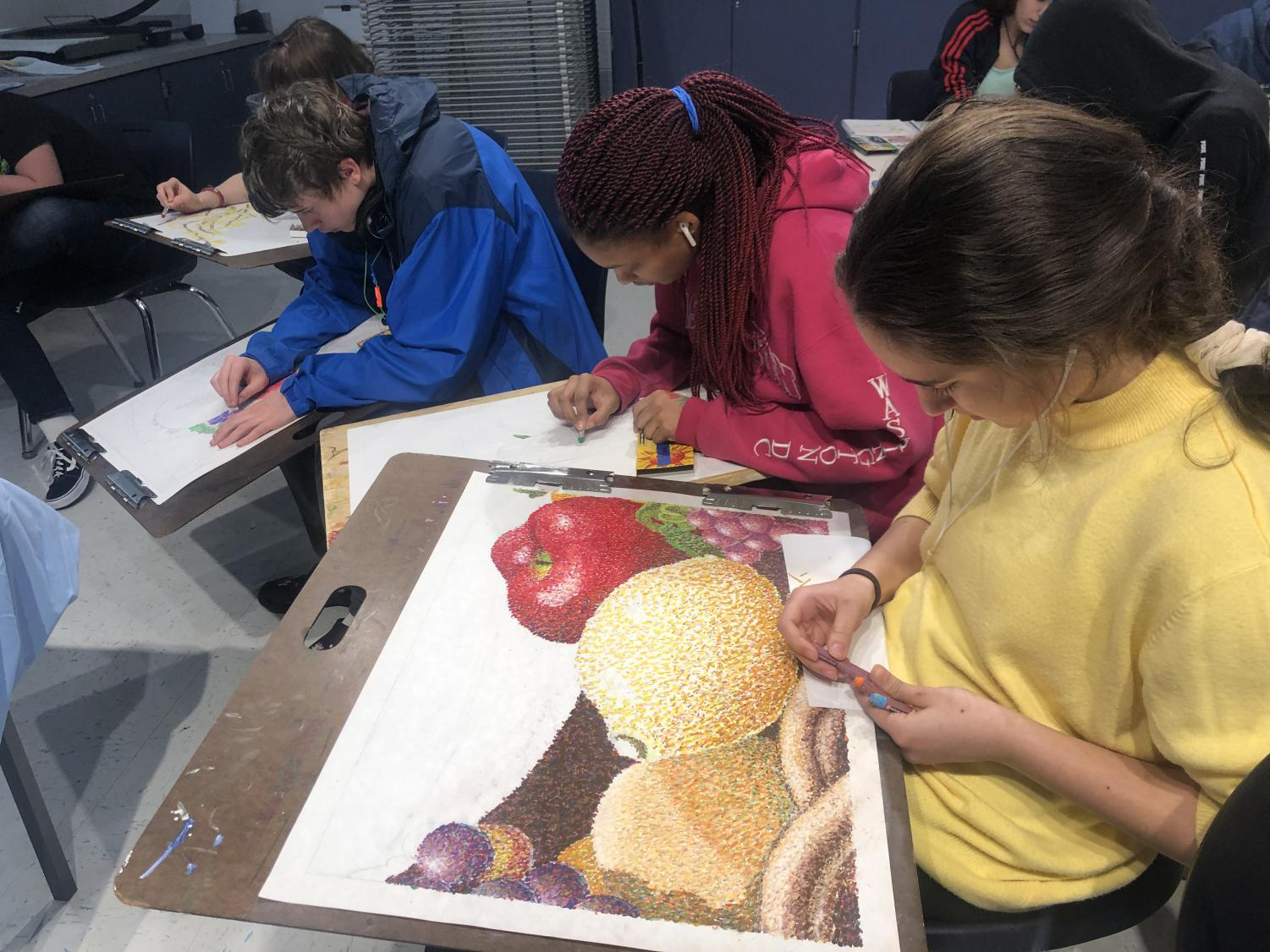 Freshman Dylan Crone, sophomore Candace Broadnax, and freshman Lauren Baptiste draw still lifes in their art class.