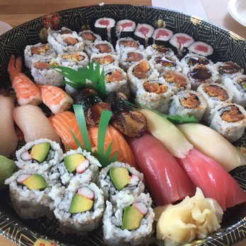 Above is a sushi platter from RAWR Sushi that includes sashimi sushi and rolls such as California Rolls and Spicy Crunchy Salmon Rolls.