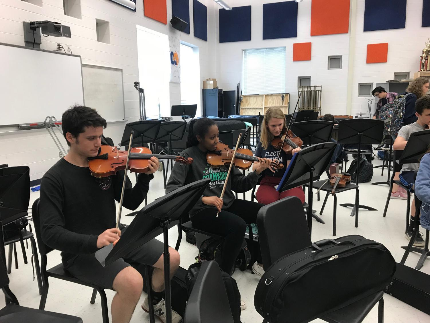 Members of the pit orchestra attend a practice after school in the band room. It takes weeks of hard work for the student musicians to master the difficult music.