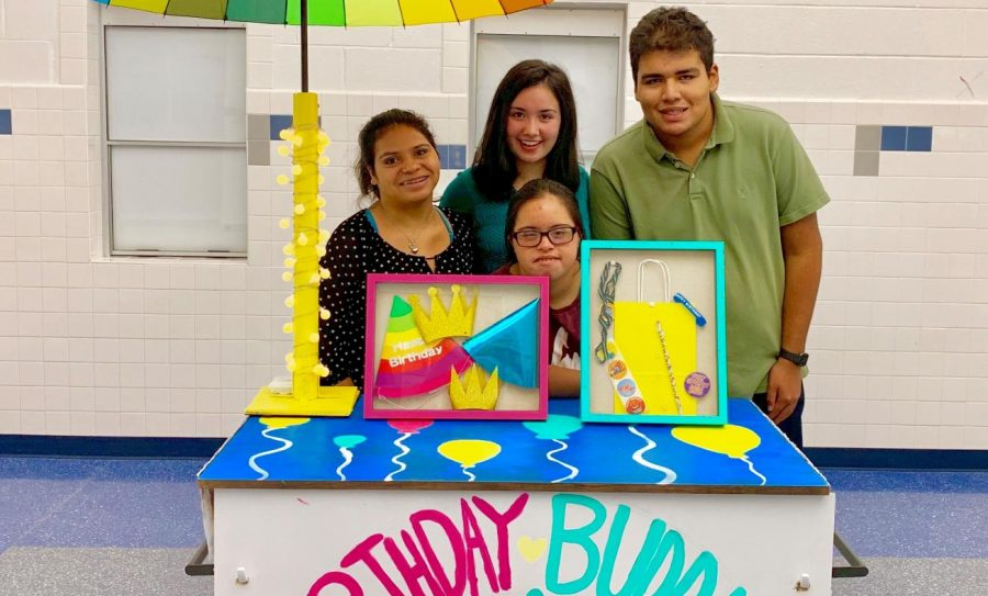 Senior Kayla Rothstein with Buddies Club members Ariana Orellana, Elaine Yepez, and Jesse Buruca. The birthday cart will be selling birthday goodies that students can buy and send to their friends on their birthdays. If their birthday falls on a weekend, the goods will be distributed on a Friday or Monday.