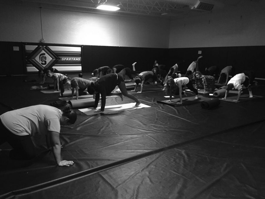 Rosie+Donaldson+teaches+her+sixth+period+yoga+class+in+the+wrestling+room.+Yoga+consists+of+many+stretches+and+poses+and+is+beneficial+to+both+one%27s+overall+physical+and+mental+health.