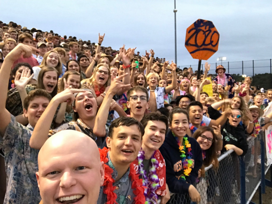 Fairfax+County+School+Board+member+Ryan+McElveen+poses+for+a+selfie+in+front+of+the+WS+student+section+at+the+Spartans%27+first+home+game+of+the+year+on+September+13th.+The+Spartans+rolled+over+the+Lee+Lancers+48-0+due+in+part+to+their+new-and-improved+play-calling.