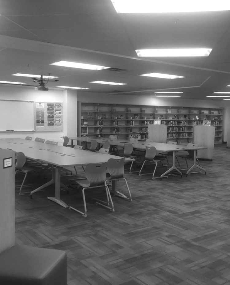 The FCPSON program removed most of the computers from WS. Here, library tables that used to have desktops sit unoccupied. Students have been advised to charge and bring their laptop, because the library is no longer a backup.