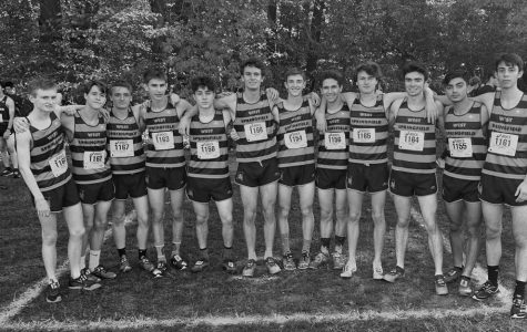 The boys' cross country team poses for a celebratory picture after taking first place at the Patriot District Championship at Burke Lake. WS had six boys place in the top ten: Sean Stuck and Sam Pritchard took first and second place ahead of Alex Asady, Chris Weeks, JJ Comely, and Nate Pohlsander. The girls' cross country team also performed well, with Katie Orchard and Amy Herrema taking second and third place, respectively.